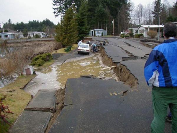 Soil liquefaction and lateral spreading in Tumwater, WA after the 2001 Nisqually Quake. Photo courtesy of UW College of Engineering