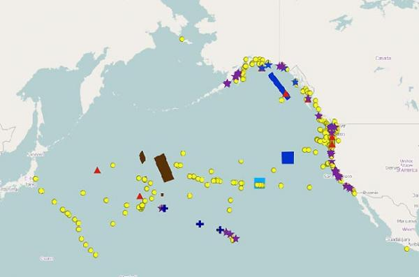 This map displays all possible tsunami debris sightings since December 2011. The red triangle designates confirmed sightings. Image via NOAA/ Coastal Response Research Center