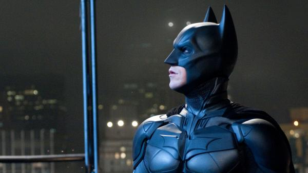<strong>Emotional Armor:</strong> Superheroes like Batman (Christian Bale) function as talismans when our fears are darkest — symbols of good, and of justice, when we wonder whether either exists.