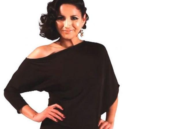 "Designer Ximena Valero <a href=""http://www.youtube.com/user/XIMENAVALERO"">uses</a> YouTube to get the word out on her signature transformable fashion, modeled here by Cindy Vela. She says joining the Latino lifestyle network Mitu will only help increase her exposure."