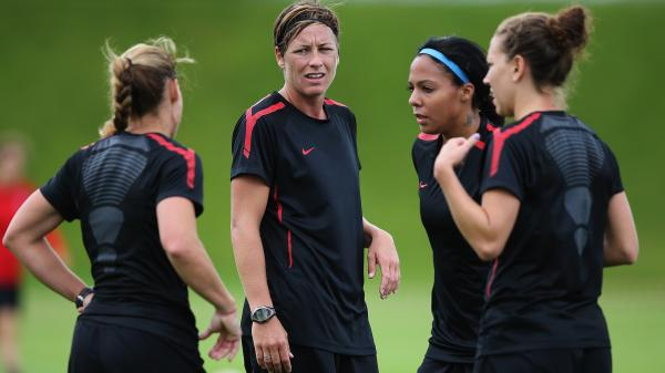 Abby Wambach (center) and other members of the U.S. women's Olympic soccer team train in Glasgow. The Americans will begin the Olympics with a match against France in Scotland Wednesday.