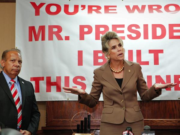 Rebecca Smith, owner of A.D. Morgan, speaks Thursday at a Tampa, Fla., event to denounce President Obama's statements about small businesses. The event was organized by the Romney campaign. At left is Lou Ramos of Value Enterprise Solutions.