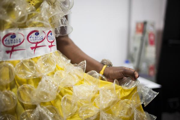 A fashion show on Tuesday evening featured dresses decorated with female condoms. Here Olwin Manyanye from Zimbabwe prepared backstage for the show, which raised awareness for the growing need of female condoms.