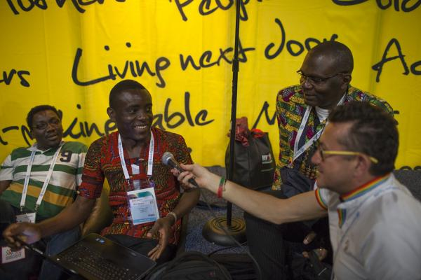 At a booth dedicated to people living with HIV, Michel Bourrelly from France handed the mic to Roger Yves from Cameroon to lead the group in an African song on Thursday afternoon.