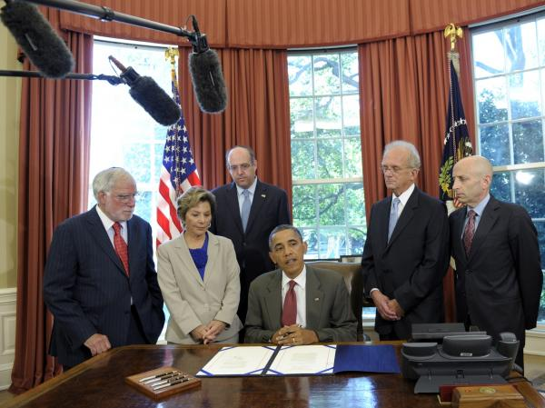President Obama is flanked Friday by congressional sponsors and officials with the American Israel Public Affairs Committee at a signing ceremony in Washington, D.C., for legislation increasing U.S. security aid to Israel.