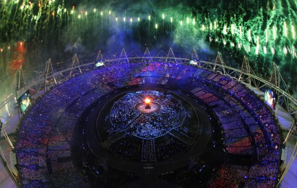 The Olympic Cauldron is lit as fireworks go off during the Opening Ceremony of the London 2012 Olympic Games at the Olympic Stadium on Friday.