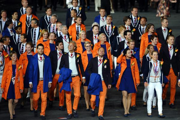 Athletes from the Netherlands walk through the Olympic stadium Friday in London.