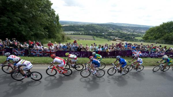 Rigoberto Uran Uran of Colombia leads a group of riders as they ride up Boxhill on the outskirts of London on July 28, 2012, during the men's cycling road race for The 2012 London Olympic Games. AFP PHOTO / MIGUEL MEDINA (Photo credit should read MIGUEL MEDINA/AFP/GettyImages)