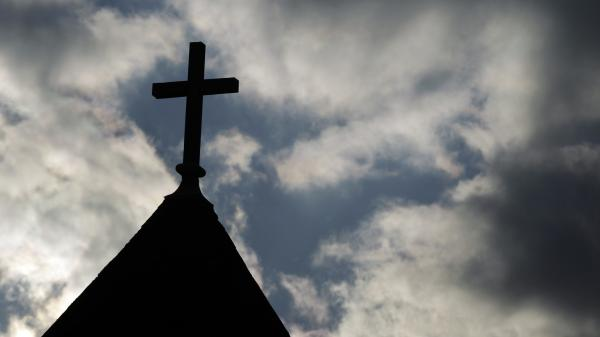 "The cross on the steeple of St. Francis Xavier Catholic Church in Henryville, Ind. A recent Gallup poll says only 44 percent of Americans have ""great confidence"" in organized religion."