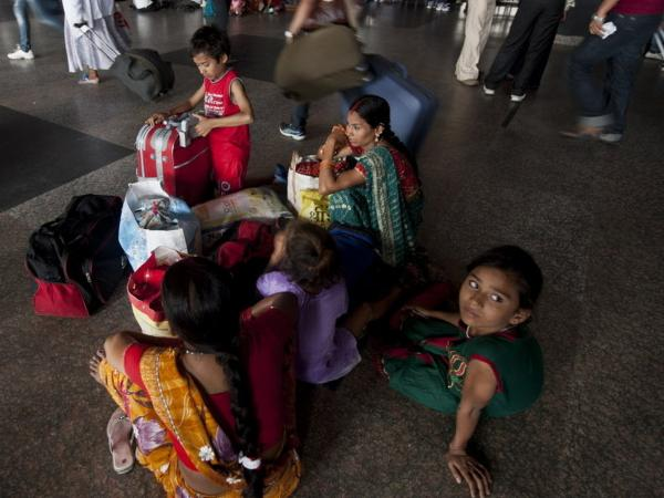 Passengers in New Delhi were waiting for trains that couldn't run because of Monday's power outage.
