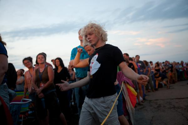 Michael Dale of Amherst, Mass., dances during Wilco.