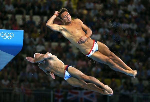Tom Daley (R) and Peter Waterfield of Great Britain compete in the Men's Synchronised 10m Platform Diving Tuesday in London, England.