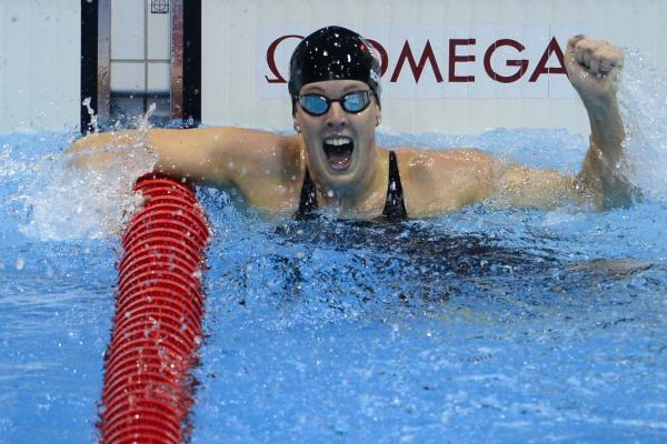 U.S. swimmer Allison Schmitt cheers after winning the women's 200m freestyle final.