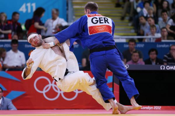 Travis Stevens of the United States (in white) competes against Ole Bischof of Germany in the Men's -81 kg Judo semifinals. Stevens lost the match.