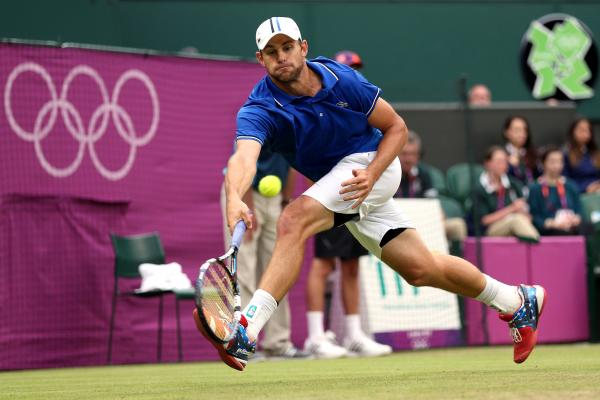 Andy Roddick of the United States returns a shot to Novak Djokovic of Serbia during the second round of Men's Singles Tennis. Roddick lost the match.
