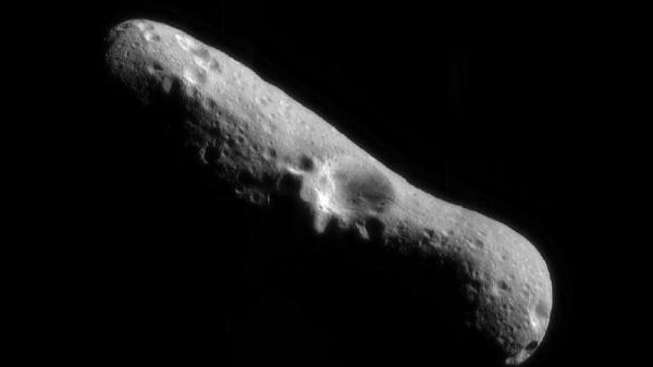 This picture of the Eros asteroid is the first of an asteroid taken from an orbiting spacecraft. The crater at the center is about 4 miles across.