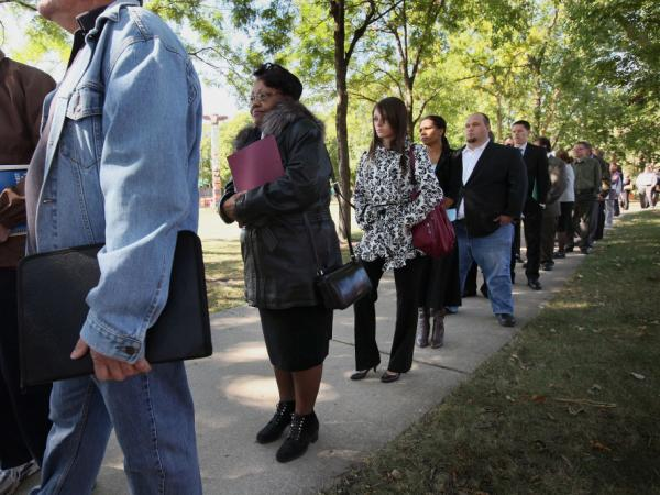 <p>Job seekers waited in line to meet with recruiters at a job fair in Park Ridge, Ill., last month. </p>