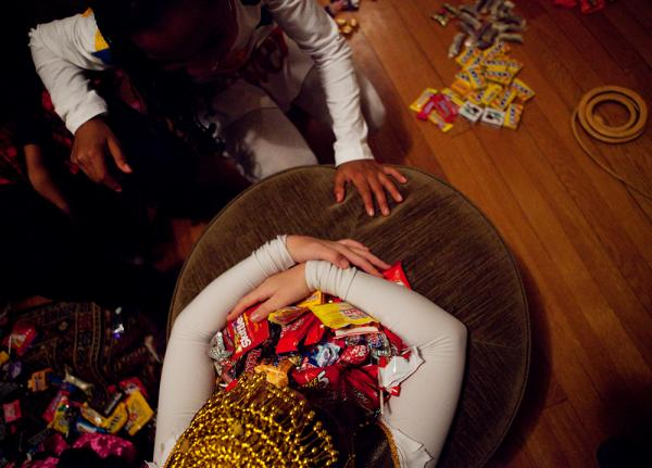<p>Sierra Lewter grabs a coveted candy after trick-or-treating on Halloween. </p>