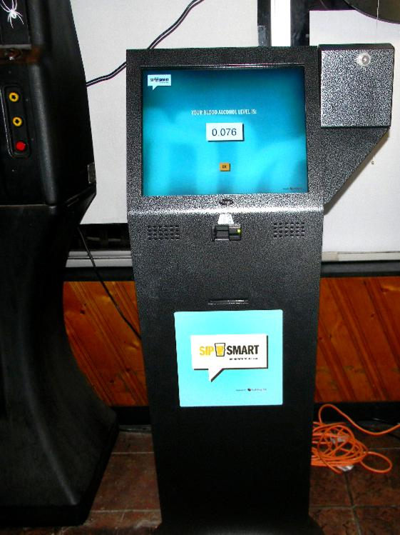 A new SipSmart kiosk awaits customers at Caputi's, a sports bar in suburban Buffalo, N.Y. Customers swipe a credit card and then blow into a plastic mouthpiece attached to the side of the machine. Seconds later, their blood-alcohol level flashes on the screen.