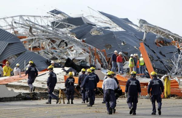 Members of Missouri Task Force One search-and-rescue team work at a Home Depot that was hit by the tornado.