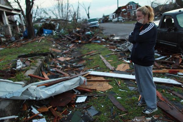 Carra Reed looks at a friend's home that was destroyed in Joplin.