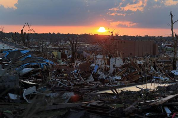 The sun rises over debris in Joplin, Mo. on Tuesday.
