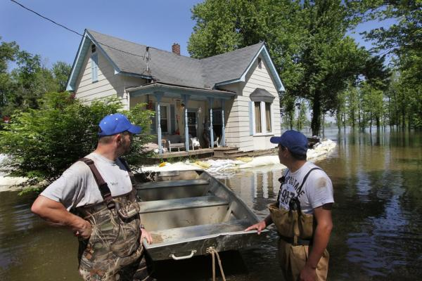 May 5: John Wade (left) and Jose Peralta haul sandbags to build a levee around Wade's Metropolis, Ill., home, which is surrounded by floodwater from the Ohio River. Heavy rains have caused widespread flooding in Missouri, Illinois, Kentucky, Tennessee and Arkansas.
