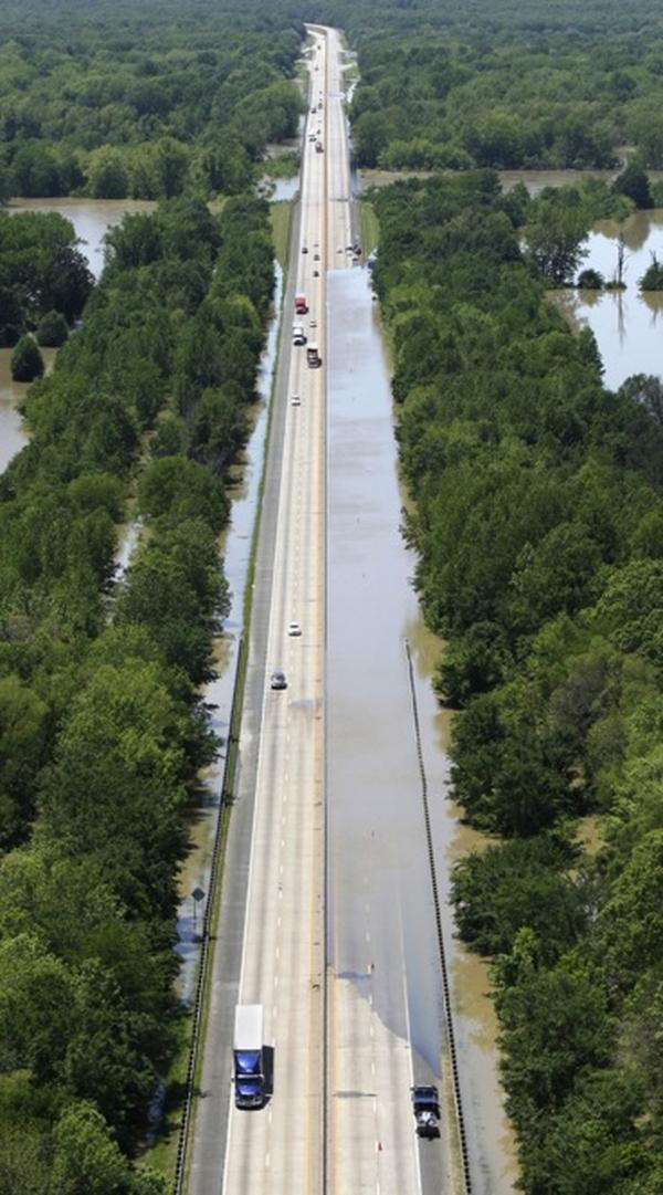 May 5: Floodwater from the White River blocks a lane of the interstate near Hazen, Ark.