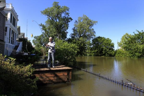 May 4: On Mud Island in Memphis, Tenn., 90-year-old Cyril Forck caught a small perch from his backyard deck, which is usually 50 feet away from the edge of the Mississippi River.