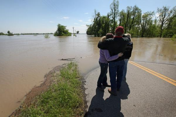 May 3: Roy Presson embraces his daughters Catherine (left) and Amanda at the edge of the road looking out at their family farm in Wyatt, Mo. The Presson home and 2,400 acres of their farmland were flooded when the Army Corps of Engineers blew a massive hole in a levee at the confluence of the Mississippi and Ohio Rivers to help save the town of Cairo, Ill.