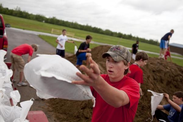 April 27: Jacob Cox, 14, piles sandbags onto a trailer with other student volunteers at Massac Junior High School. The Ohio River has started to flood part of the town in Metropolis, Ill.