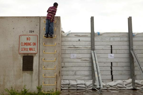 April 27: Chad Sutton, 12, looks over a levee wall holding back floodwaters from the Ohio River in Cairo, Ill.