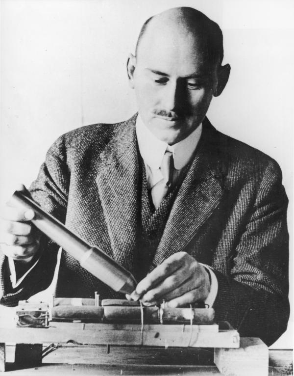 Goddard works with a steel combustion chamber and rocket nozzle, around 1915.