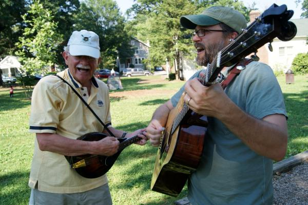 CABOMA members play guitar and mandolin.