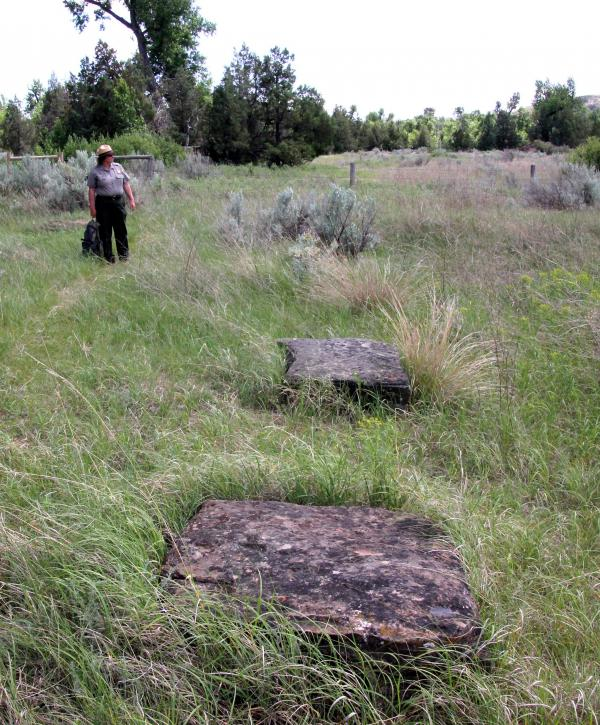 Park Superintendent Valerie Naylor points out the massive foundation stones for the ranch house.