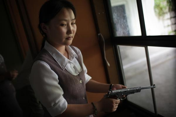 A North Korean woman loads a pistol for firing practice in Pyongyang, North Korea, August 2007.
