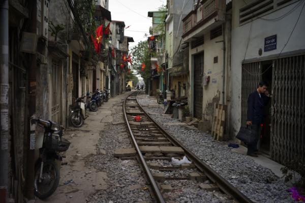 A neighborhood built along railroad tracks is seen in Hanoi, Vietnam, February 2010.