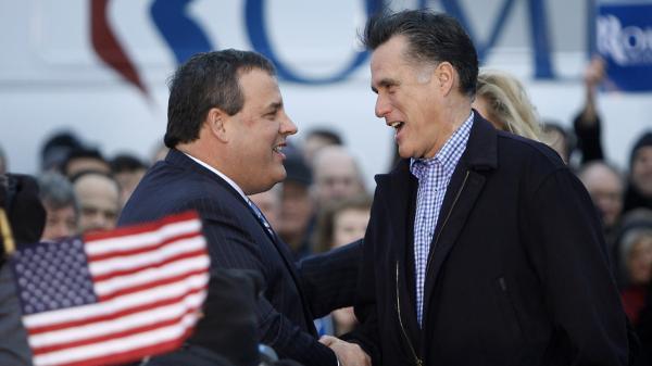New Jersey Gov. Chris Christie greets Republican presidential candidate Mitt Romney in Des Moines, Iowa, on Dec. 30, 2011.