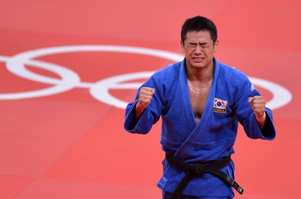 South Korea's Song Dae-Nam celerates after winning the men's 90kg judo contest final match.