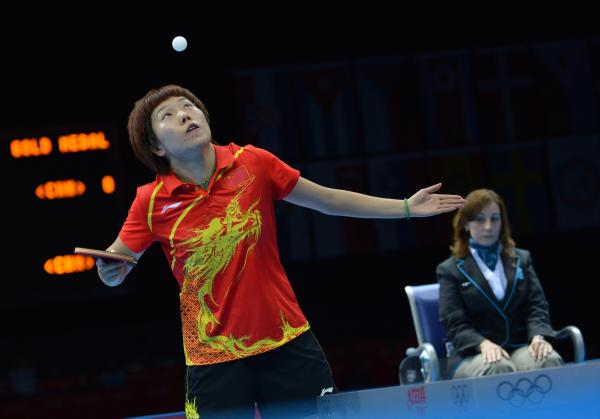 China's Li Xiaoxia serves during her table tennis women's gold medal singles match against her compatriot Ding Ning. Li won the event.