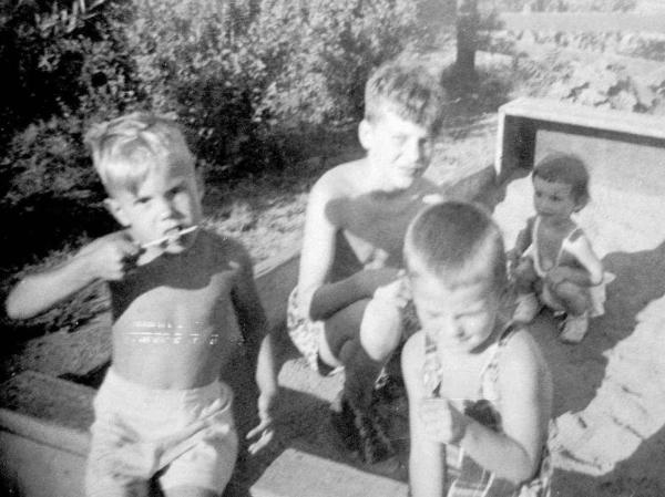 This undated family photo shows brothers David (left) and Ted Kaczynski (center) in a sandbox with neighbors.