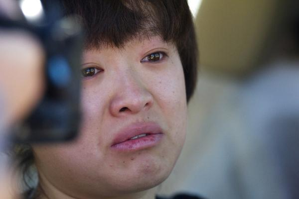 Lin Gan, 20, who was in the theater when the shooting took place, remains emotionally shaken eight hours later.