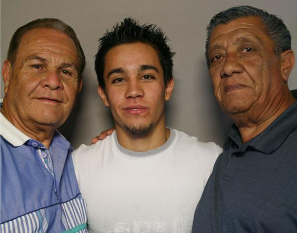 Gymnast C.J. Maestas has been tumbling since he was 18 months old. His grandfathers Frank Barela (left) and Frank Maestas have been a lifelong source of support.
