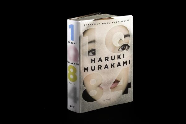 "<strong><em>1Q84</em></strong><strong> by Haruki Murakami</strong>: ""This epic, complex story begins when a woman named Aomame in 1984 Tokyo has a revelation that she has entered a universe parallel to our own. She calls it 'Q' for question, and in Japanese, Q rhymes with 9. I wanted to represent these two planes of existence with the book's jacket and its paper binding underneath."""