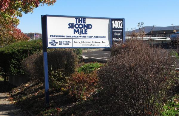 A sign for The Second Mile charity is seen outside the organization's headquarters in State College, Pa., in November of 2011.