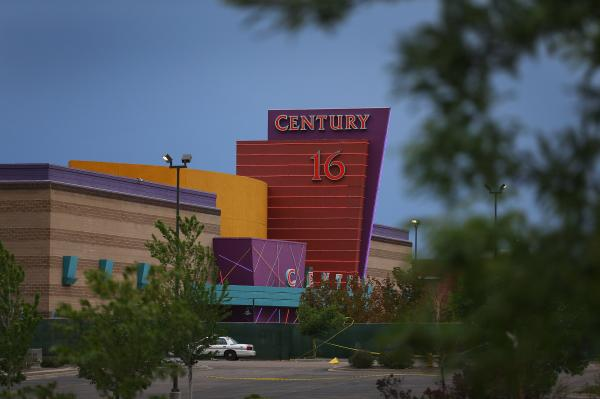 The Century 16 movie theatre is seen from a memorial setup across the street in Aurora, Colorado.
