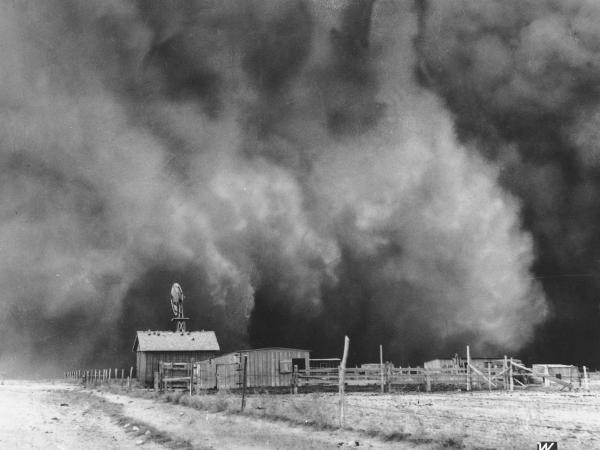 A gigantic dust cloud engulfs a ranch in Boise City, Okla., in 1935.