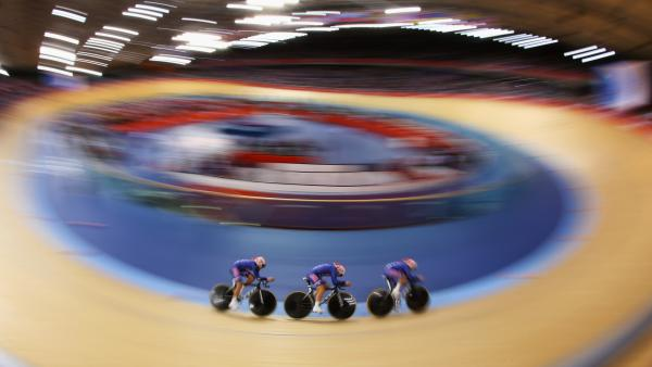 Dotsie Bausch, Jennie Reed and Sarah Hammer of the United States ride in a heat against Australia on Day 8 of the London 2012 Olympic Games at the Velodrome in London, England. The Americans took silver in the final.
