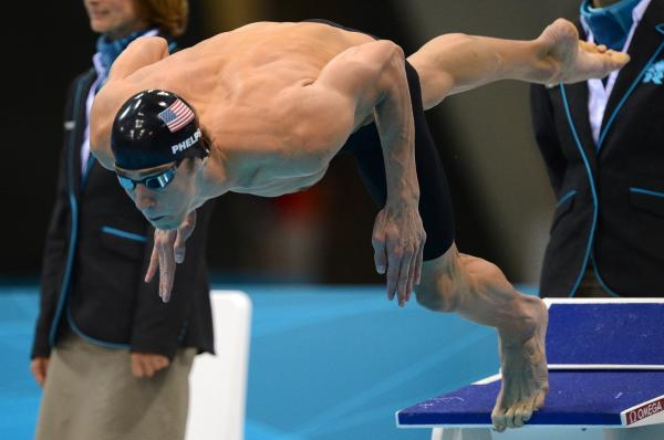 <strong>One more time:</strong> American swimmer Michael Phelps dives in to swim the butterfly leg of the men's medley relay Saturday. Phelps' team won the Olympic gold medal, giving him 22 overall and 18 gold when he leaves the London Games.