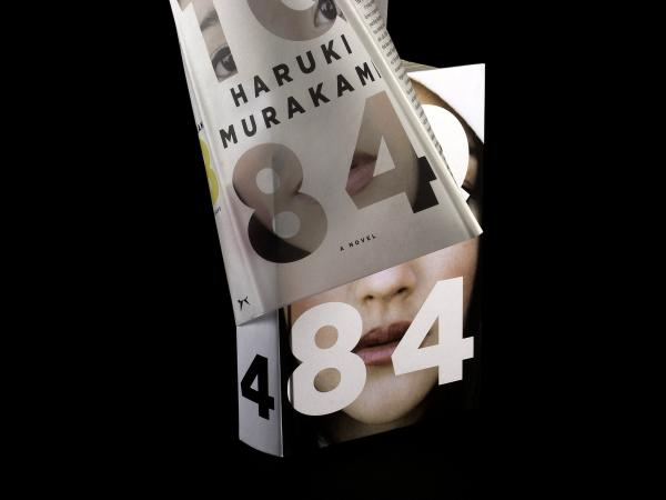 Designed by Chip Kidd, the book jacket for Haruki Murakami's <em>1Q84</em>, when removed, reveals a woman's face.